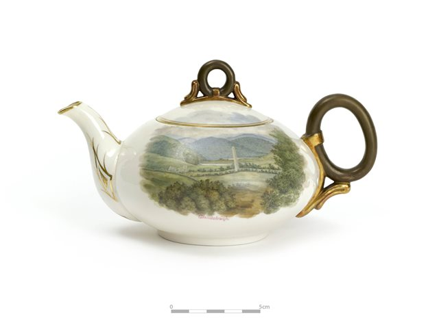 Belleek teapot decorated with scenes of Glendalough